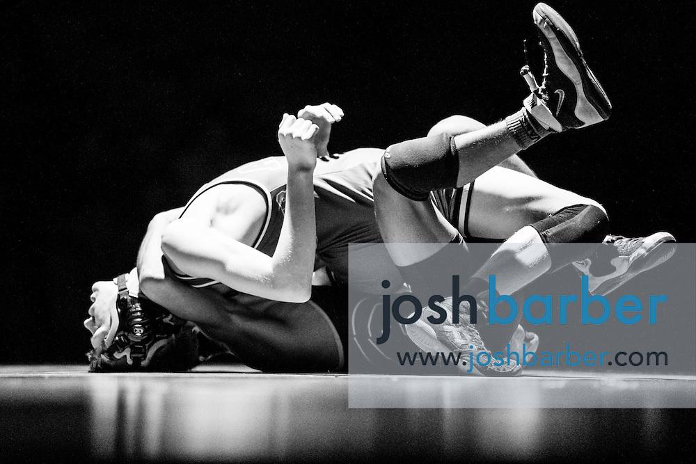 Aliso Niguel's Preston Winchester, Capistrano Valley's Andres Gonzalez during Sea View league wrestling at Capistrano Valley High School on Thursday, January 14, 2016 in Mission Viejo, California. Capistrano Valley won 43-22. (Photo/Josh Barber)