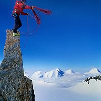 Alex Lowe (MR) atop a sub pinnacle on Mount Bearskin, Ellsworth Mts., Antarctica.