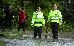 Memories return of June 2007 as heavy rains cause more flooding in Sheffield. Two houses on Ecclesfield Common are threatened by flood waters from over-flowing streams during heavy rains as Police officers and local residents who are battling the flood with buckets and hand shovels look out at the rising water level   09 June 2009 Copyright Paul David Drabble
