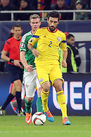 ROMANIA, Bucharest : Romania's Paul Papp (R) and Northern Ireland's Chris Brunt (L) vie for the ball during the Euro 2016 Group F qualifying football match Romania vs Northern Ireland in Bucharest, Romania on November 14, 2014.