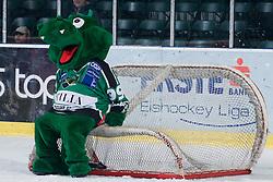 Official mascot of HDD Tilia Olimpija dragon Hoki sitting on hockey goal during ice-hockey match between HDD Tilia Olimpija and EHC Liwest Black Wings Linz in 37th Round of EBEL league, on Januar 9, 2011 at Hala Tivoli, Ljubljana, Slovenia. (Photo By Matic Klansek Velej / Sportida.com)