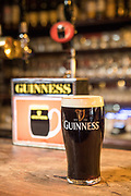 A freshly poured pint of Guinness in an Irish pub.