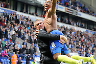 Birmingham City's manager Lee Clark celebrates in front of the traveling fans with Jordan Ibe after his side drew to stay in the Championship. Skybet football league championship match , Bolton Wanderers v Birmingham city at the Reebok stadium in Bolton on Saturday 3rd May 2014.<br /> pic by David Richards, Andrew Orchard sports photography.