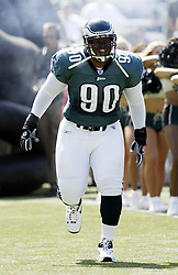 PHILADELPHIA, PA - September 22, 2002: Eagles Defensive Tackle Corey Simon (90) shown in the pregame announcements prior to the Eagles vs. Cowboys NFL Football Game at Veterans Stadium in Philadelphia, Pennsylvania this afternoon Sunday September 22, 2002. Philadelphia Eagles won in a 44-13 victory over the Cowboys, however, Simon injured his ankle in the 2nd quarter of the game. (Photo by Don Murray / Press Images)
