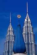 The Petronas Towers in Kuala Lumpur, designed by architect Cesar Pelli are the world's tallest buildings.