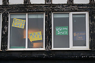 Signage in the windows during the The FA Cup match between Marine and Tottenham Hotspur at Marine Travel Arena, Great Crosby, United Kingdom on 10 January 2021.