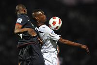 FOOTBALL - FRENCH CUP 2010/2011 - 1/2 FINAL - SCO ANGERS v PARIS SAINT GERMAIN - 19/04/2011 - PHOTO PASCAL ALLEE / DPPI - FEREBORY DORE (SCO) / ZOUMANA CAMARA (PSG)