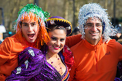 London, March 13th 2016. The annual St Patrick's Day Parade takes place in the Capital with various groups from the Irish community as well as contingents from other ethnicities taking part in a procession from Green Park to Trafalgar Square.  PICTURED: In-line skaters pose with a Bolivian dancer. ©Paul Davey<br /> FOR LICENCING CONTACT: Paul Davey +44 (0) 7966 016 296 paul@pauldaveycreative.co.uk