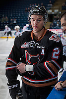 KELOWNA, CANADA - FEBRUARY 1: Jake Bean #2 of the Calgary Hitmen stands at the bench during warm up against the Kelowna Rockets on February 1, 2017 at Prospera Place in Kelowna, British Columbia, Canada.  (Photo by Marissa Baecker/Shoot the Breeze)  *** Local Caption ***