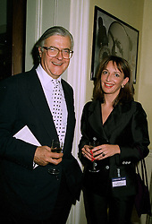 LORD BAKER and MELANIE CABLE-ALEXANDER at a party in London on 17th July 1997.MAK 18