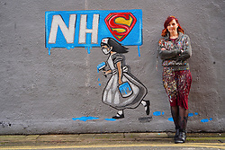 © Licensed to London News Pictures. 03/04/20. Pontefract, UK. Local artist Rachel List stand in front of a mural she has painted on the wall of the Horse Vaults pub in Pontefract, West Yorkshire in support of the NHS., West Yorkshire. Photo credit: Scott Merrylees/LNP