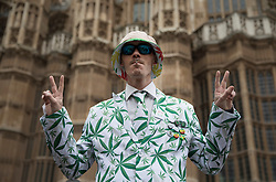 © Licensed to London News Pictures. 23/02/2018. London, UK. A campaigner wears a cannabis leaf decorated suit outside Parliament during a demonstration in support of cannabis for medicinal use - as MPs debate it's use in The House of Commons. Photo credit: Peter Macdiarmid/LNP