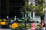 Office workers enjoy a lunchtime outside the Leadenhall Buolding during the 2018 heatwave in the City of London, the capital's financial district, on 24th July 2018, in London, England.
