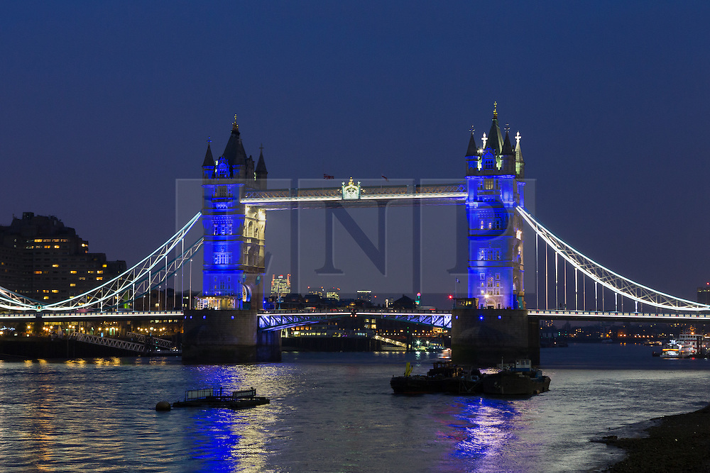 © Licensed to London News Pictures. 23/03/2016. London, UK. Tower Bridge is illuminated in BLUE, which is not one of the colours of the Belgian tricolor flag this evening, during an illumination to pay a tribute to victims of the Belgium terrorist attacks which took place yesterday. Landmarks across London are paying tribute this evening. Photo credit : Vickie Flores/LNP