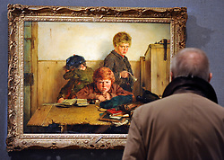 ©London News pictures. 07.02.2011. Penny Day, Head of Irish Art at Bonhams, looks at  a painting by Erskine Nichol entitled 'Kept In' expected to fetch Estimate: £30,000 - 40,000. Irish Art on display at Boham's today (07/02/11) ahead of its sale. Highlights include a portrait of Francis Bacon, one of Britain's leading 20th century artists, painted by one of his friends, Louis Le Brocquy. The watercolour, titled Image of Francis Bacon No 18, is estimated to sell for £60,000 to £80,000. The sale is held on February 8th. Bonhams, 101 New Bond Street, London, UK.. Picture Credit should read Stephen Simpson/LNP