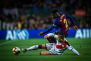 Nelson Semedo of FC Barcelona (top) fights for the ball with Embarba of Rayo Vallecano during the Spanish league football match of 'La Liga'  FC BARCELONA against RAYO VALLECANO at Camp Nou Stadium of Barcelona on March 9,2019
