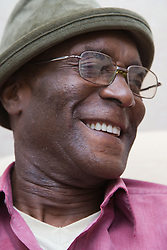Elderly man smiling,