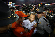 Alabama coach Nick Saban greets Clemson coach Dabo Swinney after Clemson's victory in the College Football Playoff National Championship at Raymond James Stadium in Tampa, Florida, U.S., January 9, 2017.