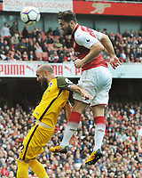 Football - 2017 / 2018 Premier League - Arsenal vs. Brighton & Hove Albion<br /> <br /> Sead Kolasinac of Arsenal out jumps Saltor Bruno at The Emirates.<br /> <br /> COLORSPORT/ANDREW COWIE