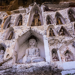 A thousand buddha images on the Irrawaddy cliffs of Akauk Thaung Mountain. The sight is situated close to the city of Pyay. The cliffside is adorned with carved resting places for 1,000 lovingly prepared homes for Buddhas.The story goes that back in the day this was a taxation point with all passing boat traffic having to pay a levy before passing onwards.