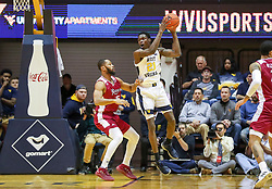 Nov 28, 2018; Morgantown, WV, USA; West Virginia Mountaineers forward Wesley Harris (21) rebounds the ball during the first half against the Rider Broncs at WVU Coliseum. Mandatory Credit: Ben Queen-USA TODAY Sports
