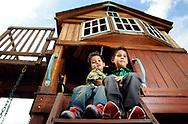 Robin Zielinski – Sun-NewsEzekiel Hernandez, 3, left, hugs his cousin Jude Collins, 6, on Tuesday on the play equipment at their grandparent's home. On July, 10th Collins saved the life of Hernandez after the 3-year-old fell into the swimming pool. The little hero will be receiving recognition for his act of bravery and citizenship today at 9 a.m. during the Doña Ana County Commission meeting.