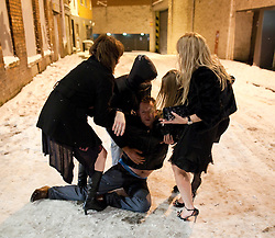 "© under license to London News Pictures. 18/12/2010 as snow blizzards hit Manchester revellers continue their ""Mad Friday"" night out. Many fell on treacherous ice"