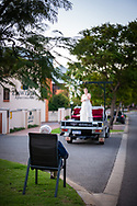 An entertainer, sings in a free performance sponsored by the Subiaco Council to lift the spirits of people self isolating during the Covid-19 lockdown in Western Australia.