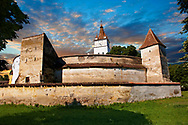 The medieval fortified church of Harman. A Romaneque church started in 1240 by the Cistercian monks with Gothic elements of architecture .Harman, Braşov, Transylvania. UNESCO World Heritage Site. .<br /> <br /> Visit our ROMANIA HISTORIC PLACXES PHOTO COLLECTIONS for more photos to download or buy as wall art prints https://funkystock.photoshelter.com/gallery-collection/Pictures-Images-of-Romania-Photos-of-Romanian-Historic-Landmark-Sites/C00001TITiQwAdS8<br /> .<br /> Visit our MEDIEVAL PHOTO COLLECTIONS for more   photos  to download or buy as prints https://funkystock.photoshelter.com/gallery-collection/Medieval-Middle-Ages-Historic-Places-Arcaeological-Sites-Pictures-Images-of/C0000B5ZA54_WD0s