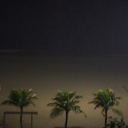Football posts and palm trees on Ipanema beach during a storm, Rio de Janeiro,  Brazil. 13th July 2010. Photo Tim Clayton..
