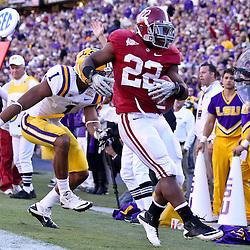 November 6, 2010; Baton Rouge, LA, USA; Alabama Crimson Tide running back Mark Ingram (22) runs past LSU Tigers cornerback Eric Reid (1) for a touchdown during the second half at Tiger Stadium. LSU defeated Alabama 24-21.  Mandatory Credit: Derick E. Hingle