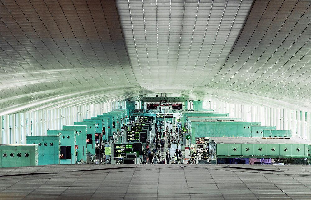 Busy terminal in the Barcelona airport, Spain