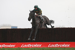 Kapcorse and Bryony Frost clear the last fence before winning The Sir Peter O' Sullevan Memorial Handicap Steeple Chase Race run during Ladbrokes Trophy Day at Newbury Racecourse.