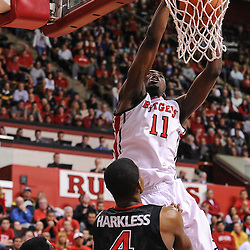 Rutgers Scarlet Knights guard/forward Dane Miller (11) slam dunks a Eli Carter (5) rebound for the game-winning basket with 11 seconds remaining during Big East NCAA Basketball action between the Rutgers Scarlet Knights and St. John's Red Storm at the Louis Brown Rutgers Athletic Center (RAC) in Piscataway, N.J. Rutgers defeated St. John's 61-58.