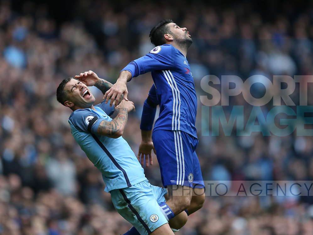 Aleksander Kolarov of Manchester City reacts to a challenge by Diego Costa of Chelsea  during the Premier League match at the Etihad Stadium, Manchester. Picture date: December 3rd, 2016. Pic Simon Bellis/Sportimage