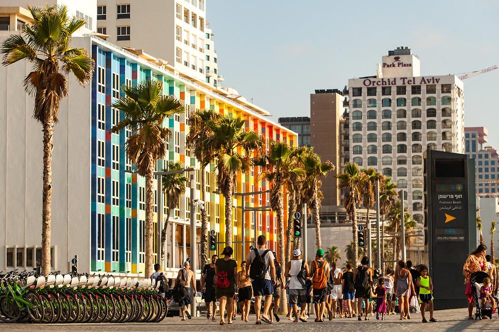 People walk and ride their bicycle along the new promenade in Tel Aviv's Merkaz Hair neighborhood