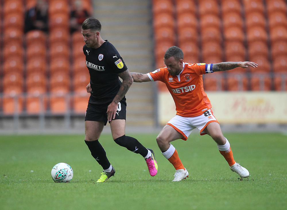 Blackpool's Jay Spearing  in action with Barnsley's George Moncur<br /> <br /> Photographer Mick Walker/CameraSport<br /> <br /> Carabao Cup First Round - Blackpool v Barnsley - Tuesday August 14th 2018 - Bloomfield Road - Blackpool<br />  <br /> World Copyright © 2018 CameraSport. All rights reserved. 43 Linden Ave. Countesthorpe. Leicester. England. LE8 5PG - Tel: +44 (0) 116 277 4147 - admin@camerasport.com - www.camerasport.com