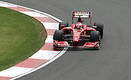 2009 Formula 1 Santander British Grand Prix at Silverstone in Northants, Great Britain. action from Friday practice on 19th June 2009. Kimi Räikkönen of Finland drives his Ferrari F1 car.
