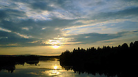 Sun Going Down Over Rural Finland from the Overnight Train -- Rovaniemi to Helsinki. Semester at Sea, Summer 2014 Voyage, Reindeer and Lappland Field Trip. Image taken with a  Fuji XT1 camera and 23 mm f/1.4 lens (ISO 1600, 23 mm, f/16, 1/500 sec). Raw image processed with Capture One Pro and Photoshop CC.