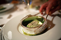 Waiter serving a dish at Restaurant Pierre Gagnaire, Paris