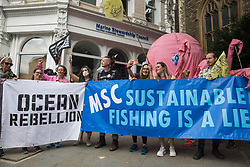 London, UK. 28th August, 2021. Activists from Ocean Rebellion stand with a model pink octopus outside the offices of the Marine Stewardship Council during a National Animal Rights March. Animal Rebellion, an offshoot of Extinction Rebellion, organised the march for the sixth day of Extinction Rebellion's protests in London, with stops at Smithfield meat market, Unilever (which owns brands that sell dairy products and use palm oil), Cargill (which is one of the world's largest meat processors) and the Marine Stewardship Council.