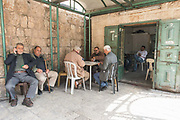 Men playing cards next to Herods Gate in the Old City on 31st March 2016 in Jerusalem, West Bank.
