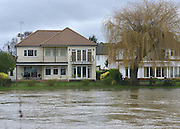 © Licensed to London News Pictures. 29/12/2012. Staines, UK Houses near the flooded Thames in Staines Upon Thames. Flooding along the River Thames today 29th December 2012.Forecasters say the UK can expect heavy rain and winds the coming days. Photo credit : Stephen Simpson/LNP