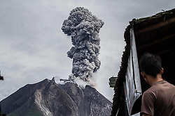 May 19, 2017 - Karo, North Sumatra, Indonesia - Villager looks on Mount Sinabung spewed thick volcanic ash rolled into the air in Karo, north sumatera province. People are urged to remain vigilant and adhere to government recommendations. It is unpredictable how long Mount Sinabung will stop erupting. Volcanic parameters and mountain seismicity remain high so that the potential for further eruptions will continue. (Credit Image: © Ivan Damanik via ZUMA Wire)