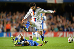 18.09.2013, Stamford Bridge, London, ENG, UEFA Champions League, FC Chelsea vs FC Basel, Gruppe E, im Bild Chelsea's Ashley Cole tackles Basel's Mohamed Salah   during UEFA Champions League group E match between FC Chelsea and FC Basel at the Stamford Bridge, London, United Kingdom on 2013/09/18. EXPA Pictures © 2013, PhotoCredit: EXPA/ Mitchell Gunn <br /> <br /> ***** ATTENTION - OUT OF GBR *****