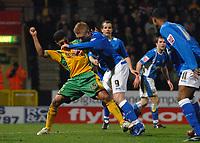 Photo: Ashley Pickering.<br /> Norwich City v Birmingham City. Coca Cola Championship. 13/03/2007.<br /> Youssef Safri of Norwich (L) tackles Mikael Forssell of Birmingham