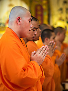 """31 JANUARY 2016 - BANGKOK, THAILAND:           Mahayana Buddhist monks participate in a prayer service before Chinese New Year at Wat Mangon Kamlawat, the largest Mahayana (Chinese) Buddhist temple in Bangkok. Thailand has the largest overseas Chinese population in the world; about 14 percent of Thais are of Chinese ancestry and some Chinese holidays, especially Chinese New Year, are widely celebrated in Thailand. Chinese New Year, also called Lunar New Year or Tet (in Vietnamese communities) starts Monday February 8. The coming year will be the """"Year of the Monkey.""""        PHOTO BY JACK KURTZ"""
