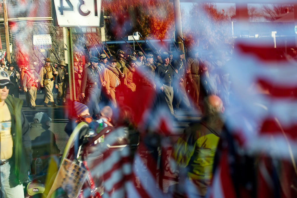 Confederate soldiers are reflected into a storefront window during a Remembrance Day Parade, celebrating the 149th anniversary of the Gettysburg Address, on November 17, 2012 in Gettysburg, PA.