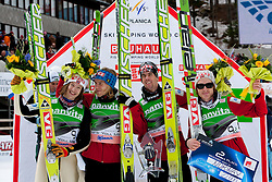 Second placed team of Norway: Tom Hilde, Bjoern Einar Romoeren, Anders Bardal and  Johan Remen Evensen celebrate at flower ceremony during Flying Hill Team at 3rd day of FIS Ski Jumping World Cup Finals Planica 2011, on March 19, 2011, Planica, Slovenia. (Photo by Vid Ponikvar / Sportida)