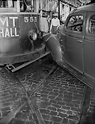 """Ackroyd 00069-35. """"Vic Schulman. Car accident. June 8, 1945"""" Portland trolley collision, car 555 MT Hall. Bus turning on to Morrison bridge at the corner of SW Front & Morrison."""